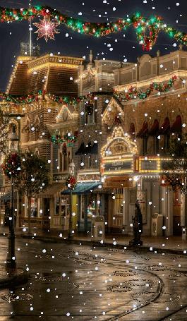 Фото Праздничный ночной город с падающим и тающим на дороге снегом