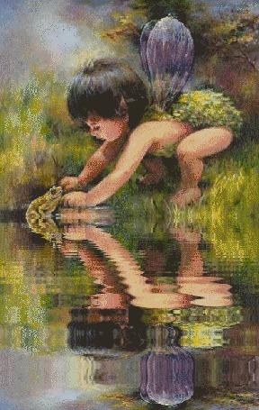Фото Маленький ребенок играет с лягушкой