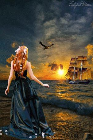 Фото На закате девушка, с цветами в волосах, стоит у моря, смотрит в даль на проплывающий парусник и парящую птицу