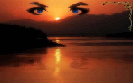 Фото Синие глаза на фоне заката, над озером, вдали видны горы