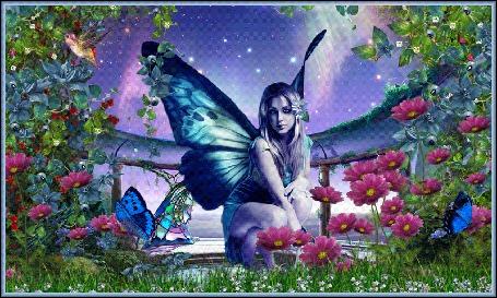 Фото Девушка с крыльями отдыхает среди цветов ночного сада