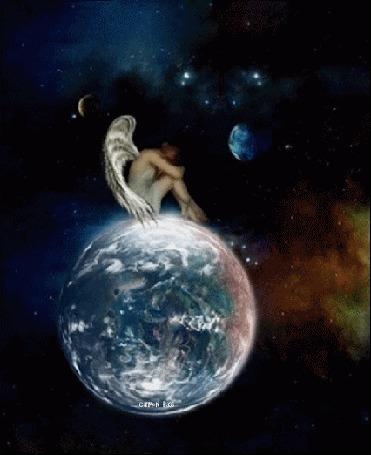 Фото Девушка - ангел сидит на планете