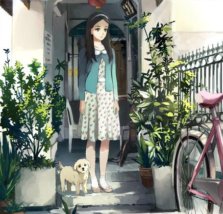 Фото Девушка и щенок на крыльце дома