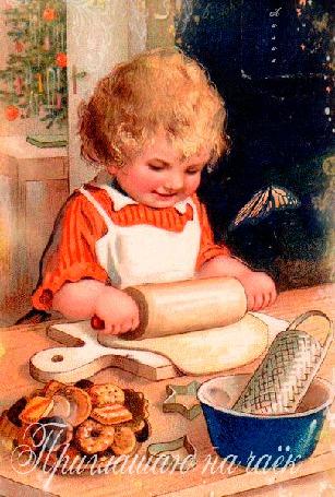 Фото Мальчик стоит за столом и катает тесто для печенья