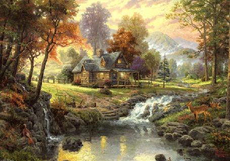 Фото В осеннем лесу охотничий домик, со светящимися окнами, стоит у ручья впадающего в пруд, где плавают утки, на берегу пруда косуля с детенышем пришли на водопой