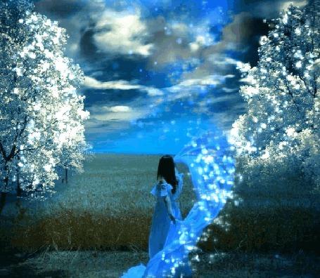 Фото Девушка стоит на фоне деревьев в весеннем цвету