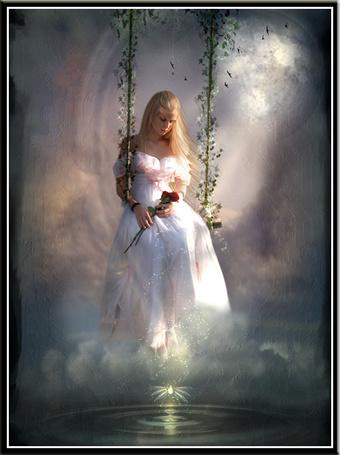 Фото Девушка сидит на качели над водой и держит в руке красную розу