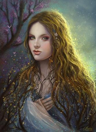 Фото Девушка стоит рядом с цветущим деревом