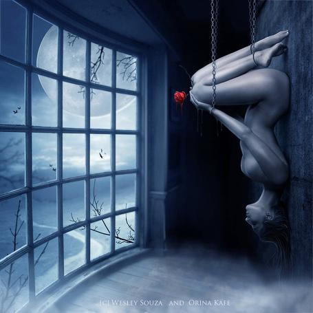 Фото Подвешенная за цепи девушка с розой в руках висит вниз головой у каменной стены, за окном видна полная луна, By Artorifreedom