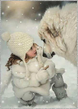 Фото Девочка и пес под падающим снегом