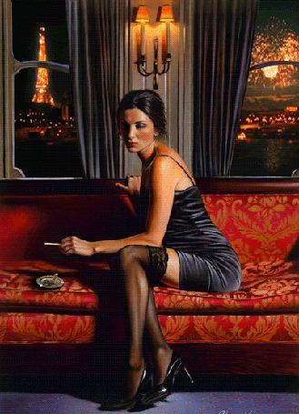 Фото Девушка сидит на диване с сигаретой в руке