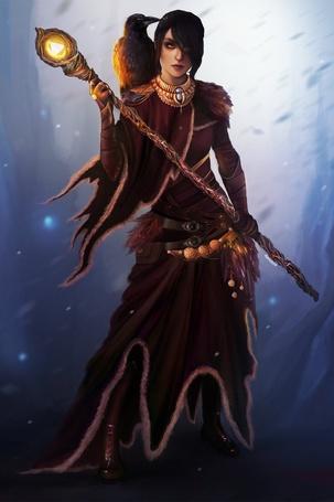 Фото Девушка с вороном на плече держит в руках посох