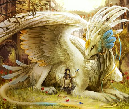Фото Парень в окружении птиц сидит возле большого фэнтезийного животного
