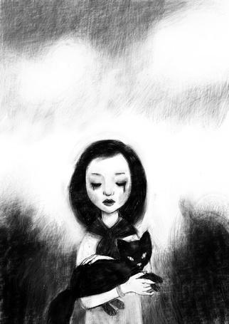 Фото Девочка держит на руках черного котенка