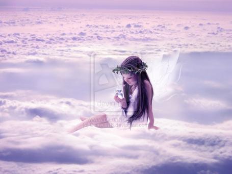 Фото Девочка с венком на голове и с крылышками феи сидит на облаках и держит в руках волшебный флакончик, by claudia18