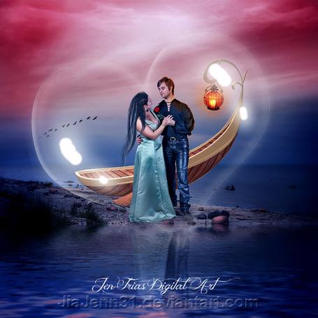 Фото Влюбленные мужчина и женщина с розой в руке, стоящие в обнимку на каменистом, морском побережье невдалеке от лодки с висящим и горящим на носу фонарем на фоне заката на вечернем, пасмурном небосклоне и прозрачном очертании сердечка вокруг влюбленных, автор Jia Jenn31