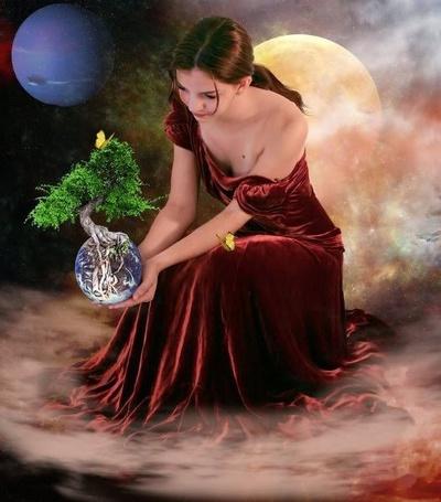 Фото Девушка в красном платье присела на фоне неба с Луной и Солнцем и держит в руках земной шар, с растущим из него деревом, на котором сидит бабочка