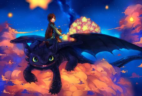 Фото Мальчик с мешком звезд сидит на черном драконе (Арт по мультфильму Как приручить дракона / How to Train Your Dragon)