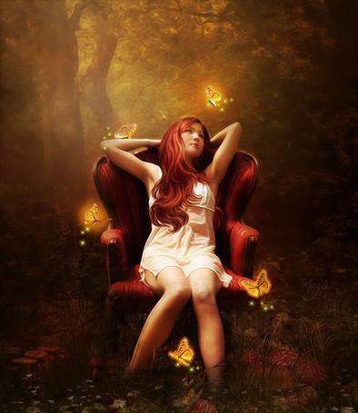 Фото Девушка сидит в кресле, которое стоит посреди леса, в окружение светящихся бабочек, работа Marjie79