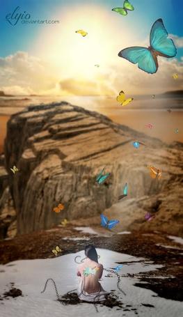 Фото Девушка с дырой, из которой вылетают разноцветные бабочки, в спине, сидит на снегу, прикованная цепями к горе, работа MyStarryDream