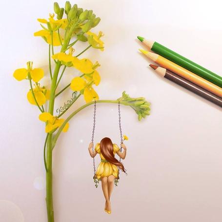 Фото Девочка на качели, подвешенной к цветку