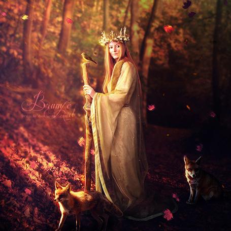Фото Девушка в длинном платье с посохом, на котором сидит птичка, идет по осеннему лесу, рядом две лисицы