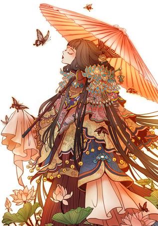 Фото Девушка под зонтом стоит среди цветов