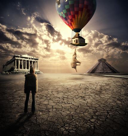 Фото Девушка, стоящая на потрескавшейся земле невдалеке от разрушенного здания с колоннами и пирамиды, наблюдает за взлетом воздушного шара, поднимающего дом и прицепившегося хоботом слона, автор Chirstina