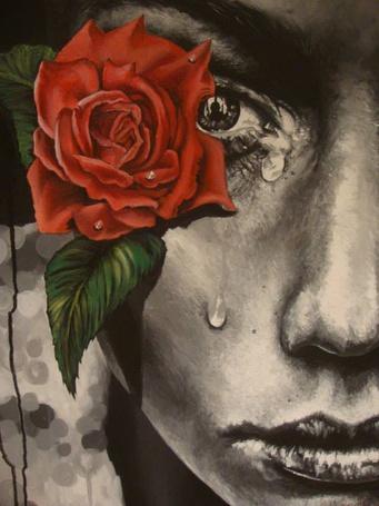 Фото Девушка с розой и слезой на лице