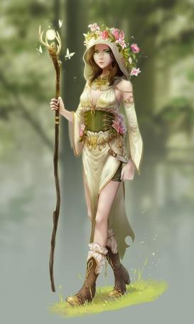Фото Девушка с веночком из цветов на голове держит в руке магический посох