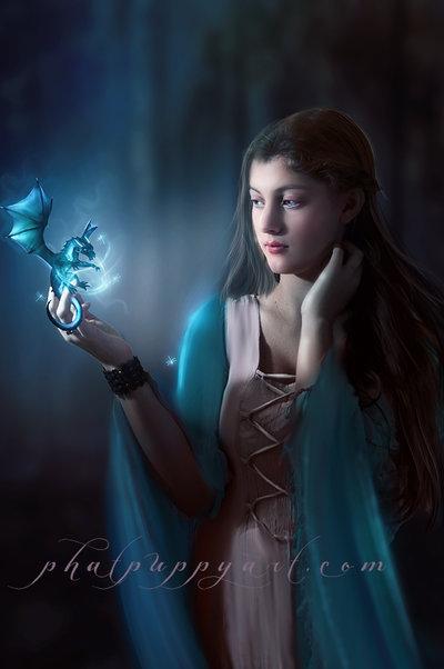 Фото Девушка смотрит на дракончика, сидящего у нее на ладоне