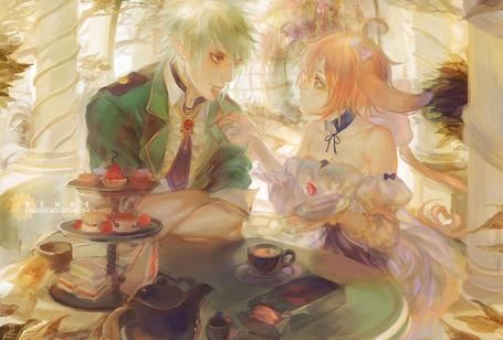 Фото Девушка с ушками кормит парня-эльфа тортиком