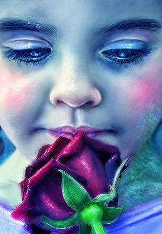 Фото Девочка нюхает бутон красной розы