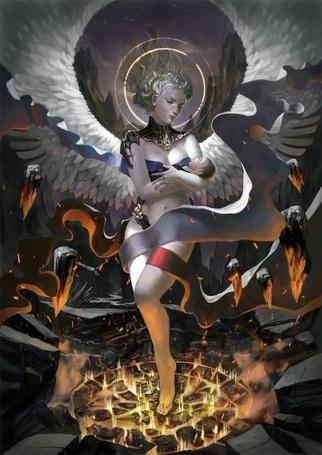 Фото Девушка-ангел стоящая в магическом круге, держит на руках младенца