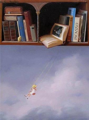 Фото Девочка на качели, подвешенной к книге