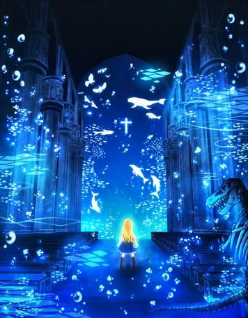 Фото Светловолосая девушка находящаяся внутри замка под водой, смотрит на рыб плавающих рядом