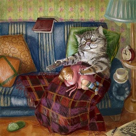 Фото Кот сидит на диване укрытый пледом, с пультом от телевизора в лапе, на ногах его спит девочка, рядом стоит чашка с блюдцем, торшер с будильником, на полу лежат кроссворды с ручкой, книжка, тапочек