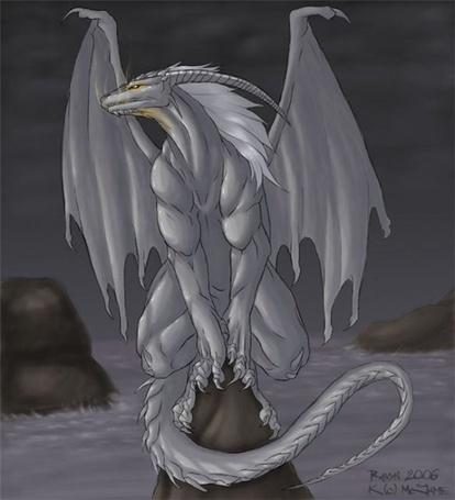 Фото Серебряный дракон на скале посреди моря