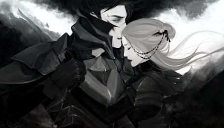 Фото Парень в доспехах целует девушку в лоб