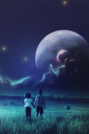 Фото Мальчик и девочка смотрят на планеты в небе