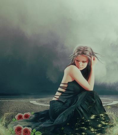Фото Девушка сидит под хмурым небом на каменной дороге, в окружении красных роз и кружащих зеленых листьев