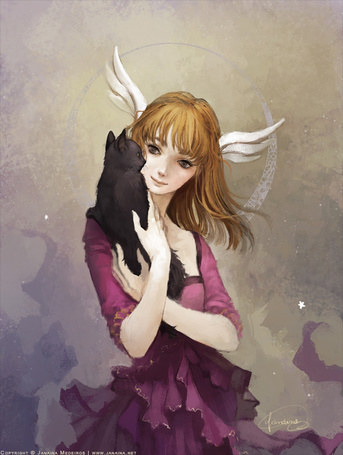 Фото Девушка с крыльями на голове держит на руках черного котенка