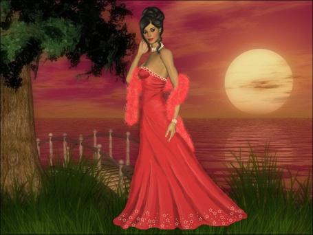 Фото Красивая девушка стоит на берегу моря под деревом на фоне ночного неба и луны