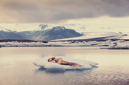 Фото Девушка - русалка лежит на ледяном островке на фоне заснеженных гор, by Emma McEvoy