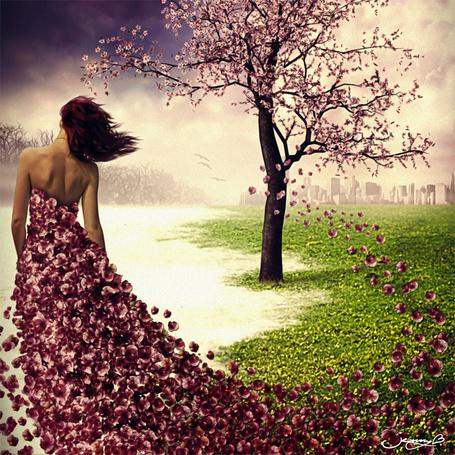 Фото Девушка в платье из весенних лепестков, слетающих с дерева, стоит к нам спиной, by lenyca