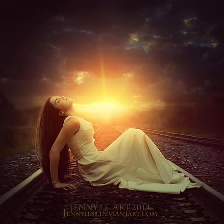 Фото Девушка сидит на железной дорогое перед идущим поездом, by JennyLe88
