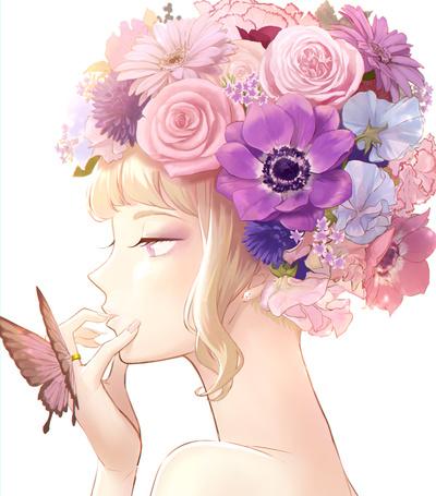 Фото Девушка с цветами в волосах и бабочкой на пальце