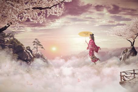 Фото Девушка парит над туманом, и горами с цветущими сакурами, by davidmitas
