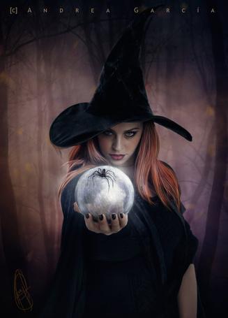 Фото Ведьма держит в руке магический шар, by Andrea Garcia