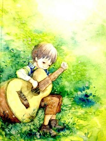 Фото Мальчик играет на гитаре